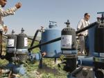 Technician works on water pumping purposes in Deir Alla, 30 June 2014. PHOTO AFP © EU/NEIGHBOURHOOD INFO CENTRE